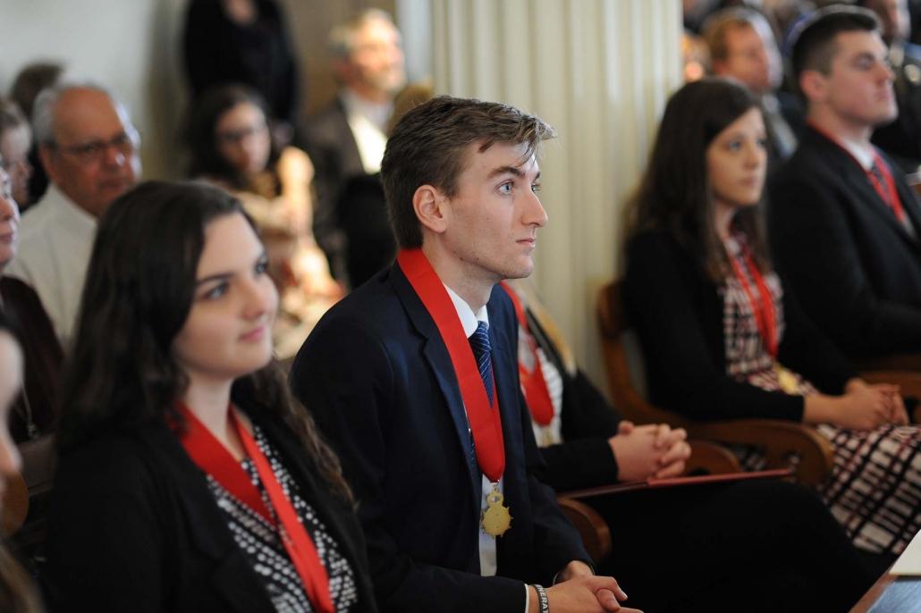 Student Laureates listening to speeches